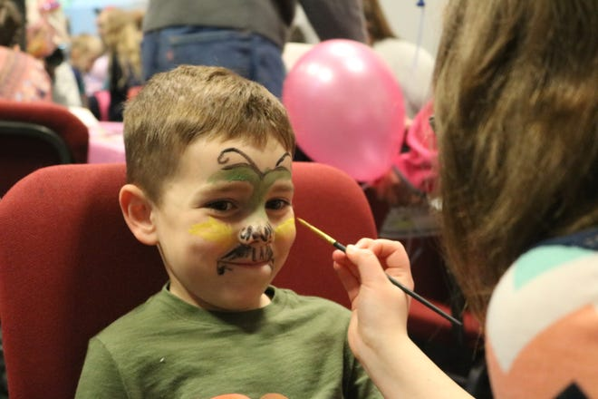 Colton Nease, of Fremont, gets his face painted at the Hayes Easter Egg Roll at the Hayes Presidential Library and Museums.