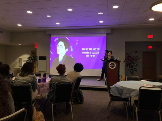 Kathy Tu speaks to a group of students about her podcast.