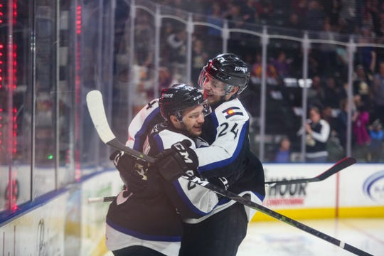 Colorado Eagles forwards Andrew Agozzino, left, and A.J. Greer celebrate one of Agozzino's three goals in a 4-1 Game 2 win over Bakersfield on Friday at the Budweiser Events Center.
