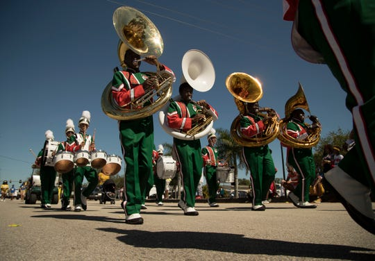 The Dunbar High School band marches in the annual Dunbar Easter Parade. They're one of 21 Southwest Florida marching bands performing their halftime shows at a Florida Bandmasters Association event Oct. 26 at Fort Myers High.