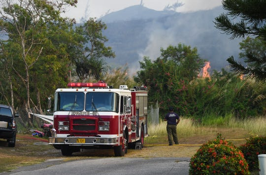The Guam Fire Department's Engine-01 ressponds to a grass fire in Santa Rita on April 21, 2019.