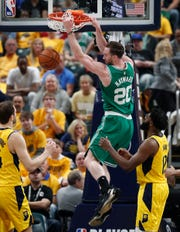 Boston Celtics forward Gordon Hayward (20) slams down two point over Indiana Pacers guard Tyreke Evans (12) in the first half of their game at Bankers Life Fieldhouse on Sunday, April 21, 2019.