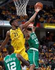 Indiana Pacers forward Thaddeus Young (21) and Boston Celtics forward Marcus Morris (13) fight for a rebound in the second half of their game at Bankers Life Fieldhouse on Sunday, April 21, 2019. The Boston Celtics defeated the Pacers 110-106.
