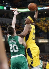 Indiana Pacers center Myles Turner (33) goes up for a dunk on Boston Celtics forward Gordon Hayward (20) in the first half of their game at Bankers Life Fieldhouse on Sunday, April 21, 2019.