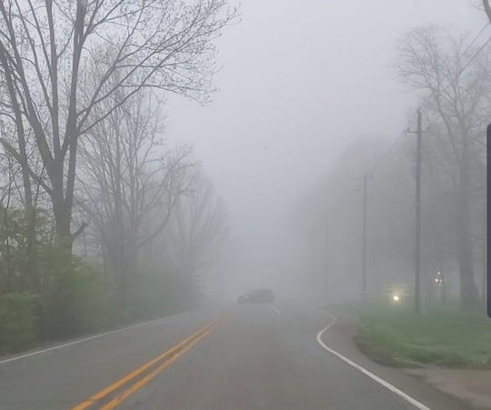 Thick fog covers the road Sunday morning in the area of Township Line Road and West 79th Street.