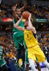 Indiana Pacers forward Domantas Sabonis (11) is fouled by Boston Celtics center Al Horford (42) in the second half of their game at Bankers Life Fieldhouse on Sunday, April 21, 2019. The Boston Celtics defeated the Pacers 110-106.