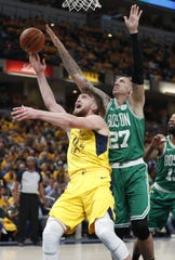 Indiana Pacers forward Domantas Sabonis (11) shoots around Boston Celtics forward Daniel Theis (27) in the first half of their game at Bankers Life Fieldhouse on Sunday, April 21, 2019.