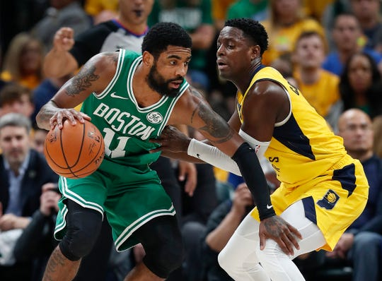 Indiana Pacers guard Darren Collison (2) defends Boston Celtics guard Kyrie Irving (11) in the second half of their game at Bankers Life Fieldhouse on Sunday, April 21, 2019. The Boston Celtics defeated the Pacers 110-106.
