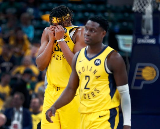 Indiana Pacers center Myles Turner (33) and Darren Collison (2) walks off the court during a timeout late in the fourth quarter of their game at Bankers Life Fieldhouse on Sunday, April 21, 2019. The Boston Celtics defeated the Pacers 110-106.