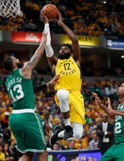 Indiana Pacers guard Tyreke Evans (12) drives on Boston Celtics forward Marcus Morris (13) in the second half of their game at Bankers Life Fieldhouse on Sunday, April 21, 2019. The Boston Celtics defeated the Pacers 110-106.