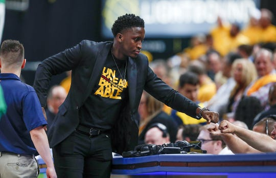 On Pacers wish list: Get well soon, Victor Oladipo. The injured Oladipo greeted a worker at the scorers' table on April 21.