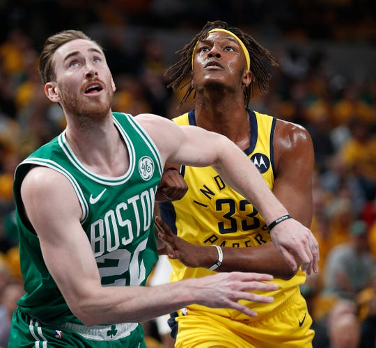 Indiana Pacers center Myles Turner (33) fights for position under the basket with Boston Celtics forward Gordon Hayward (20) in the first half of their game at Bankers Life Fieldhouse on Sunday, April 21, 2019.