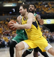 Indiana Pacers forward Bojan Bogdanovic (44) drives around Boston Celtics guard Kyrie Irving (11) in the first half of their game at Bankers Life Fieldhouse on Sunday, April 21, 2019.