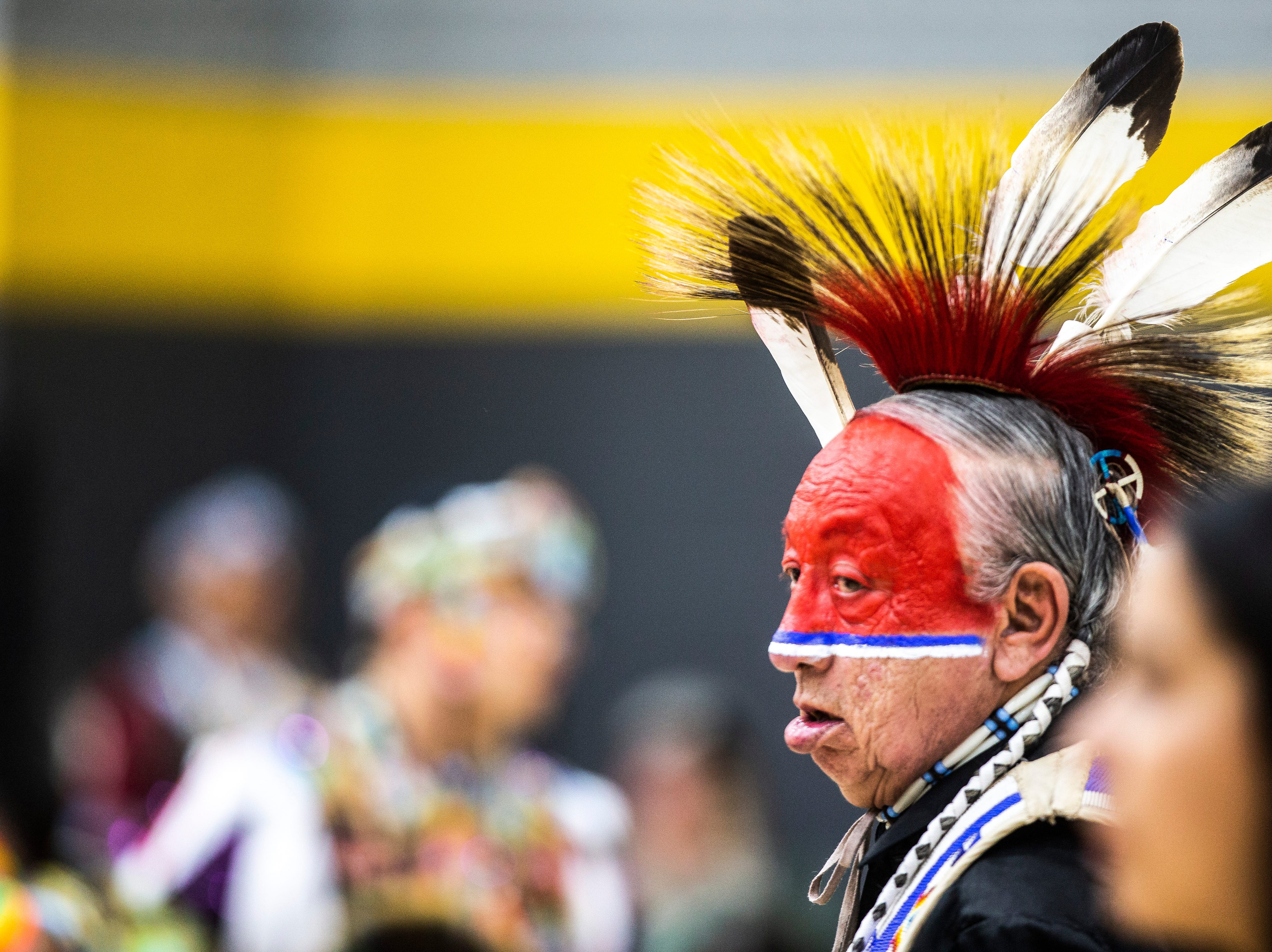 Terry Fiddler, of the Cheyanne River Sioux Tribe in Eagle Butte, South Dakota, dances during the 25th annual University of Iowa powwow, Saturday, April 20, 2019, at the Field House on the University of Iowa campus in Iowa City, Iowa.