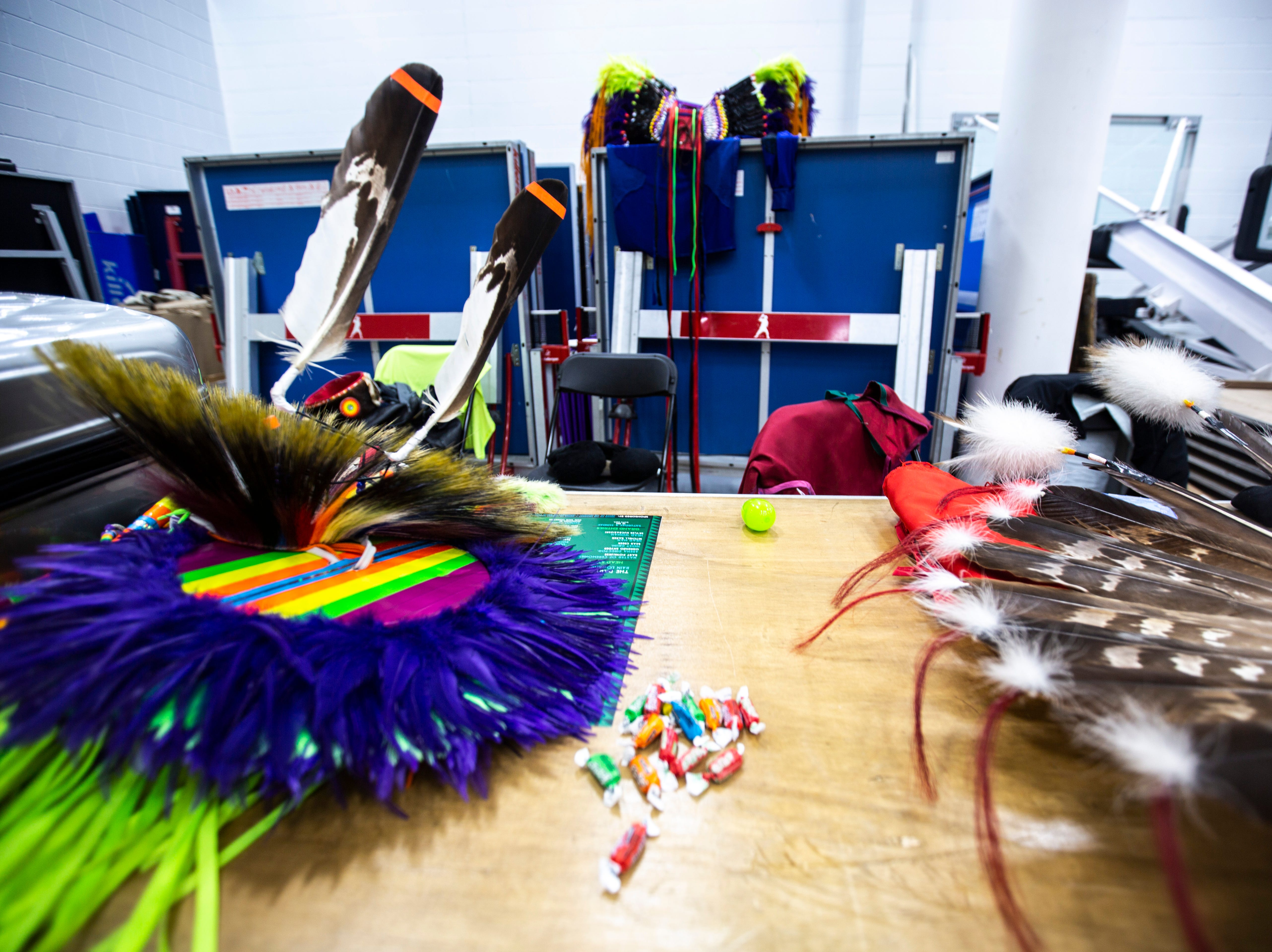 Items sit on tables between dances during the 25th annual University of Iowa powwow, Saturday, April 20, 2019, at the Field House on the University of Iowa campus in Iowa City, Iowa. The event had eight different styles dance contests for participants to enter in.