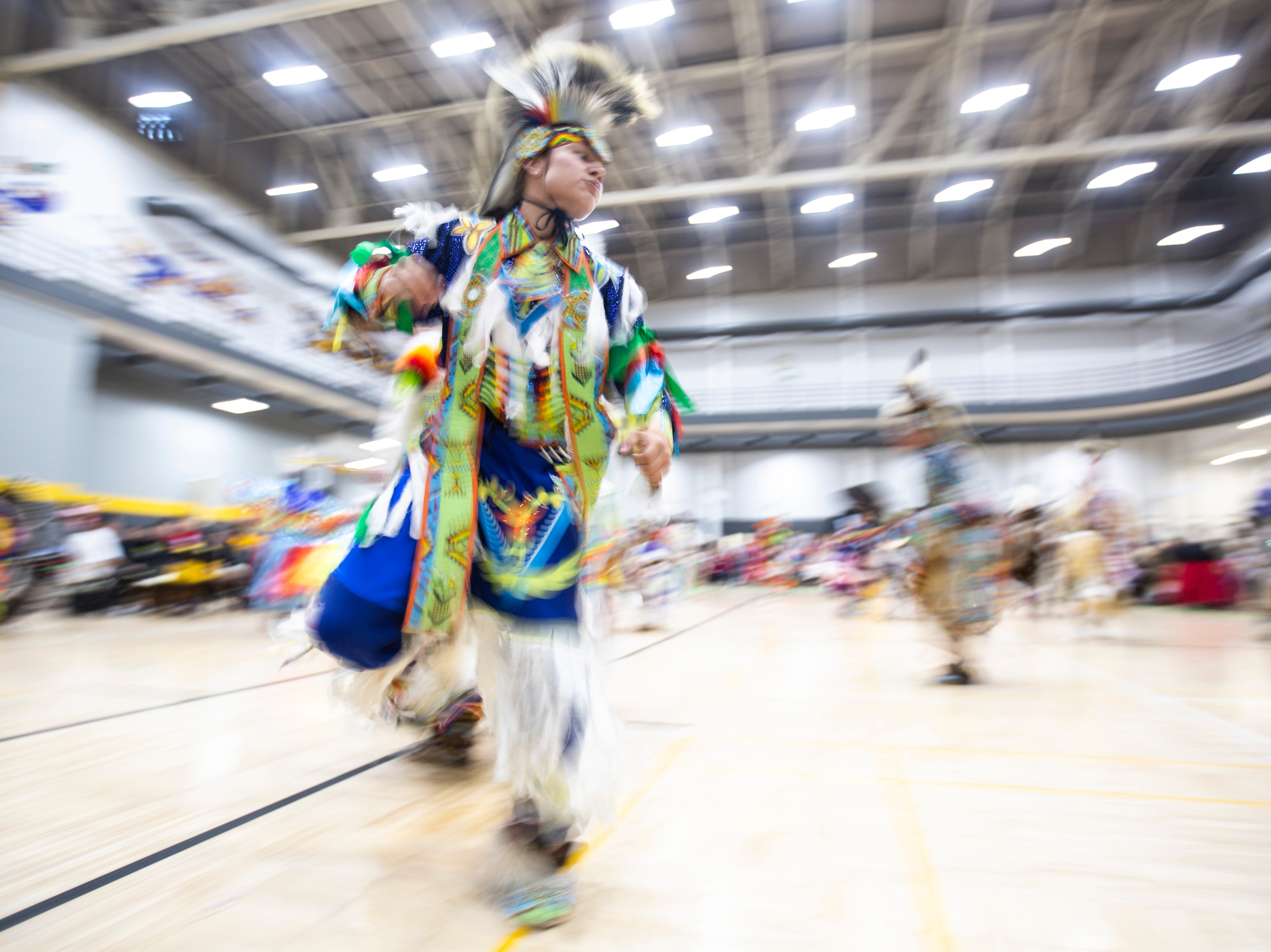 Tyrin Lasley, 17, of the Meskwaki Indian settlement in Tama, Iowa, dances during the 25th annual University of Iowa powwow, Saturday, April 20, 2019, at the Field House on the University of Iowa campus in Iowa City, Iowa. Lasley has attended every powwow with his family since he was born.