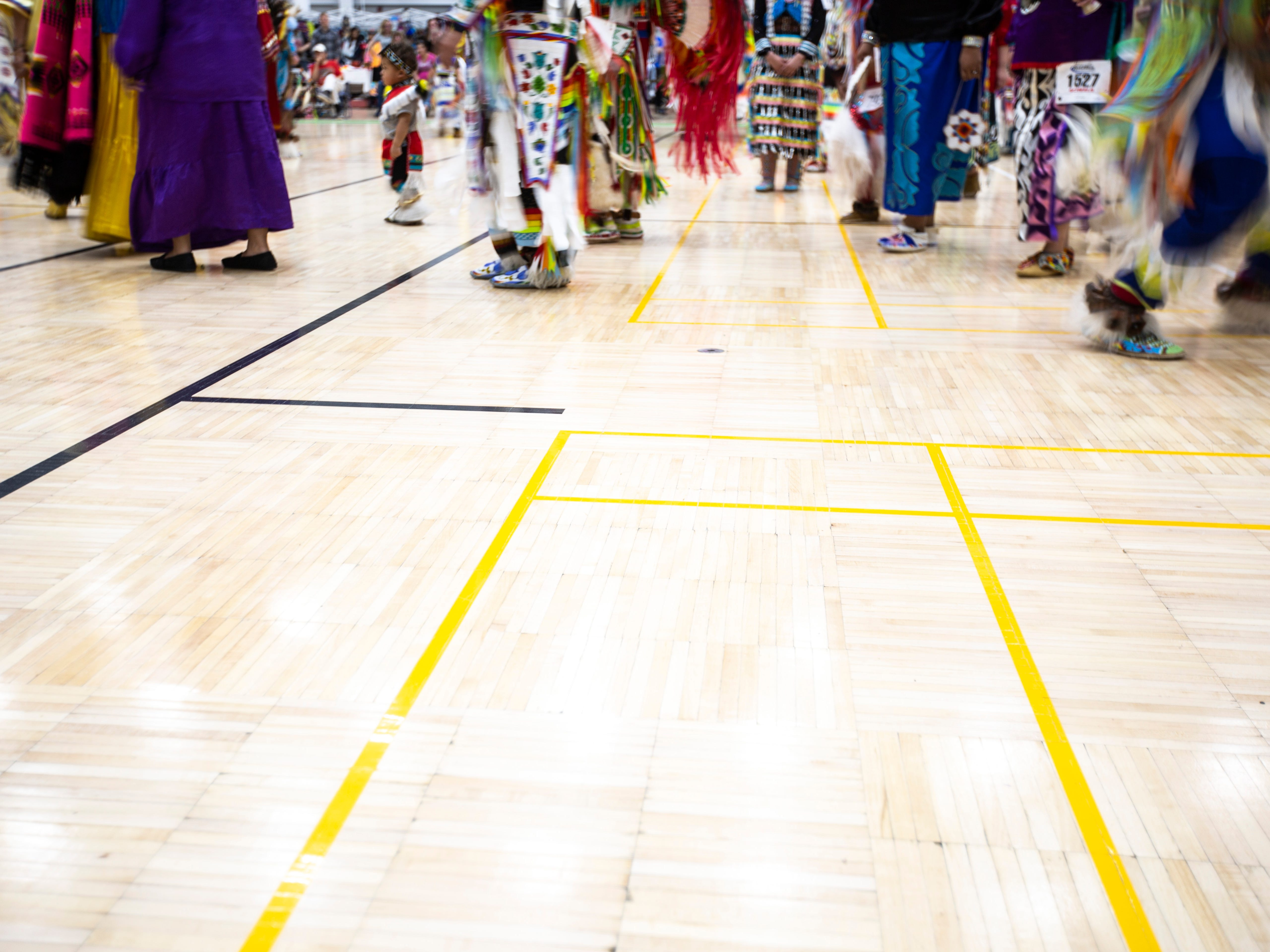 People dance during the 25th annual University of Iowa powwow, Saturday, April 20, 2019, at the Field House on the University of Iowa campus in Iowa City, Iowa. Native American Student Association organizers describe the event as a celebration of American Indian song and dance, tradition, and education.