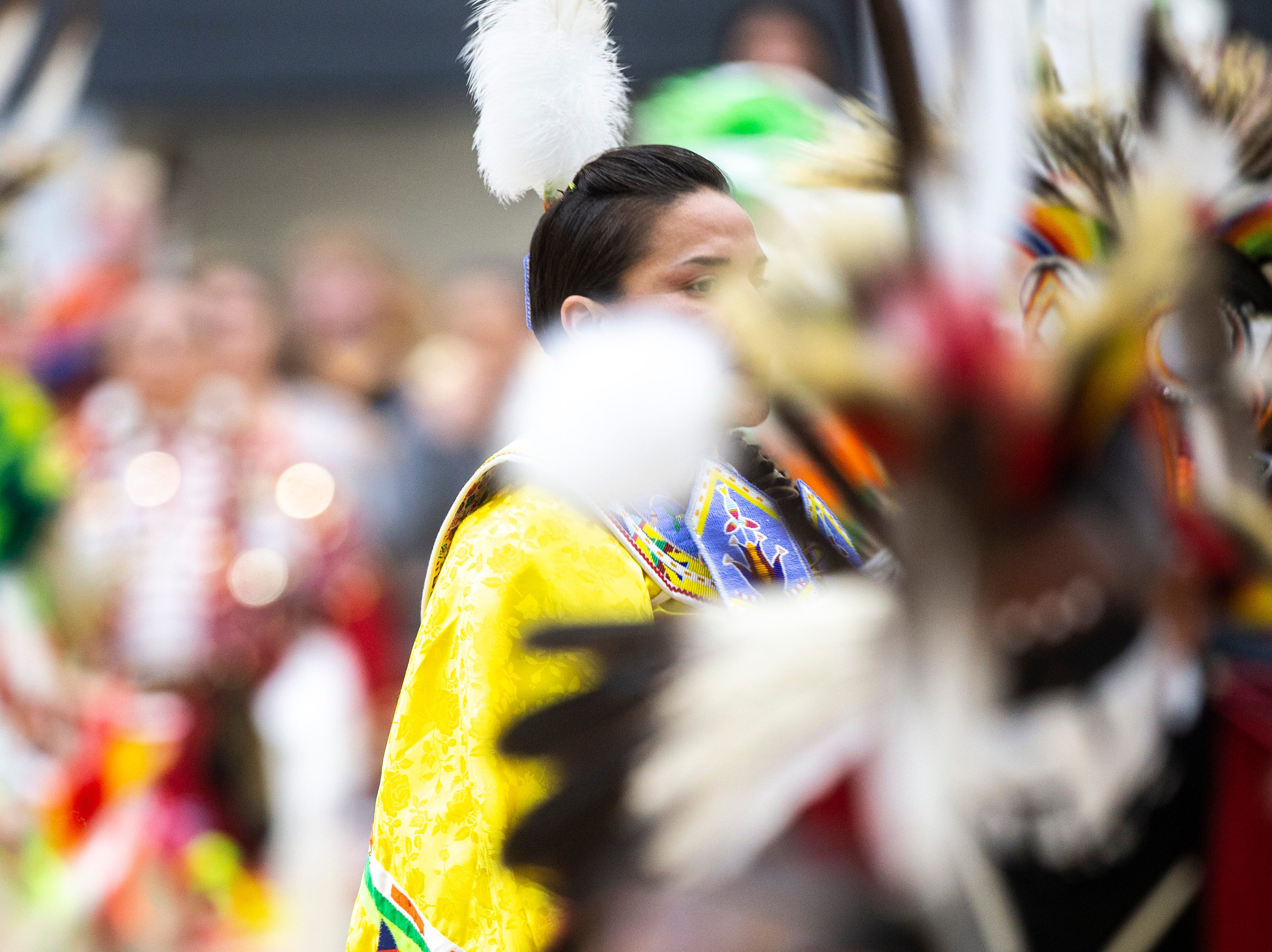 Nahmi Lasley, of the Comanche and Dakota tribes in Tama, Iowa, dances during the 25th annual University of Iowa powwow, Saturday, April 20, 2019, at the Field House on the University of Iowa campus in Iowa City, Iowa. Lasley and her children participated in dances during the event.