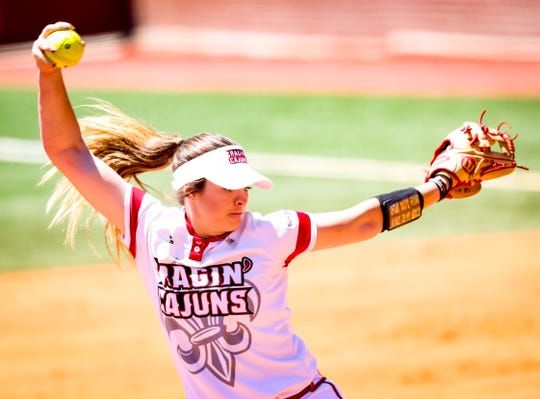 UL pitcher Summer Ellyson winds up the pitch in the circle during the final game of the series between the Ragin' Cajuns and Georgia State at Lamson Park in Lafayette Saturday, April 20, 2019.
