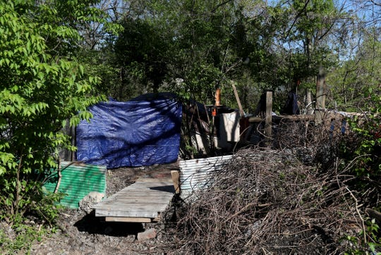 A homeless camp next to CSX railroad tracks has 10 days to clear out. It is north of Lexington Road and east of Liberty Street, in between the railroad tracks and South Fork Beargrass Creek, in the Irish Hill neighborhood. April 21, 2019
