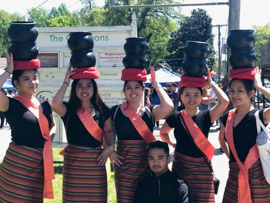 Ericka Landicho, Karen Talens, Kristin Talens, David Kaw, Thanh Le and Krystel Matutino, left to right, pose for a photo after performing at the Second Annual Binghampton International Festival