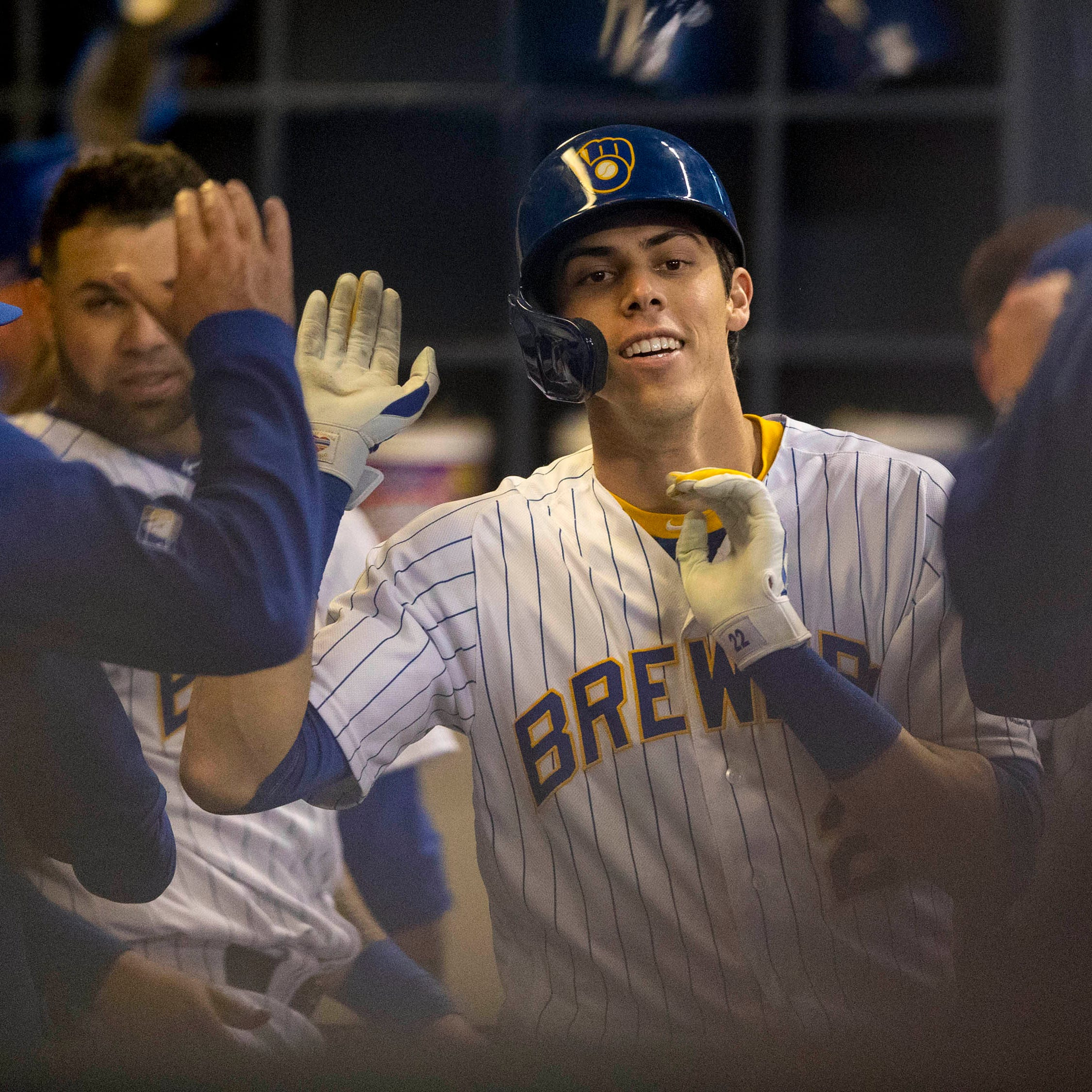 Christian Yelich celebrates his second home run...