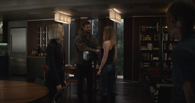 "Black Widow (Scarlett Johansson, left), Thor (Chris Hemsworth, second from left) and War Machine (Don Cheadle, right) get acquainted with Captain Marvel (Brie Larson) in ""Avengers: Endgame."""