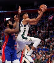 Bucks forward Giannis Antetokounmpo, drives for a layup against the Pistons' Andre Drummond.