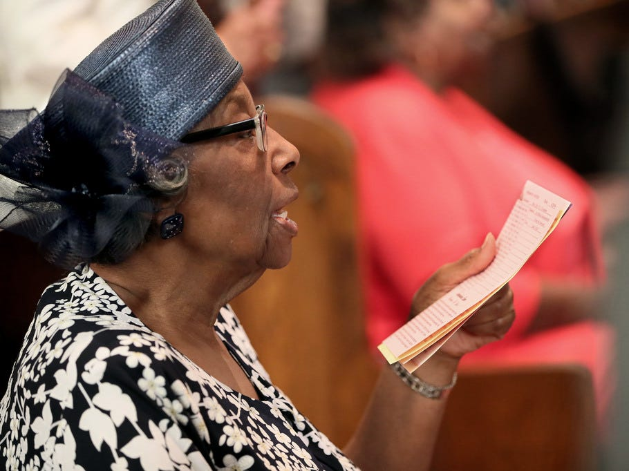 Annette Montgomery follows along with a reading during the service.