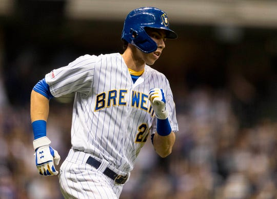 Brewers right fielder Christian Yelich rounds the bases after hitting a home run during the sixth inning. It was his second of the game and 13th of the season.