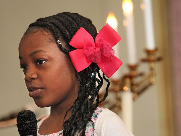Laila Smith-Marable, 9, takes part in telling the Easter story in poems and readings.