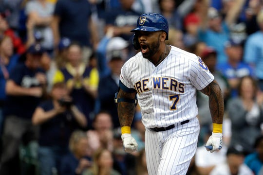 Eric Thames is pumped as he rounds the bases after hitting a three-run homer off Dodgers closer Kenley Jansen in the bottom of the eighth inning to tie the game.