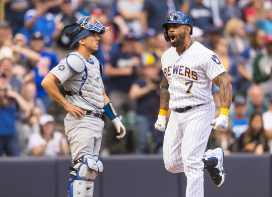 Eric Thames reacts after hitting a three-run homer during the eighth inning against the Los Angeles Dodgers at Miller Park.