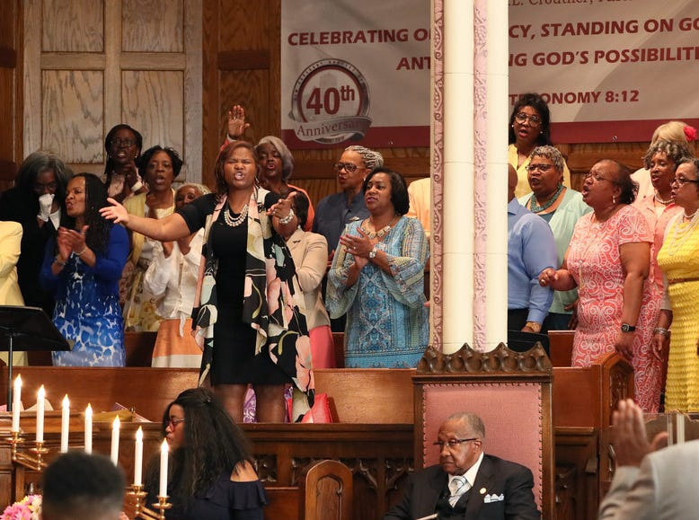 Youth Director Stacy Crouther, top center, leads the choir.  Pastor F.L. Crouther is seated, lower center.