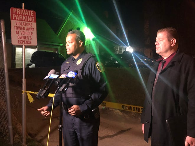 Inspector Jutiki Jackson speaks to media Saturday night near North 13th Street and West Capitol Drive after a police chase and crash. The man fleeing police died when his car crashed into a house and caught fire, authorities said.