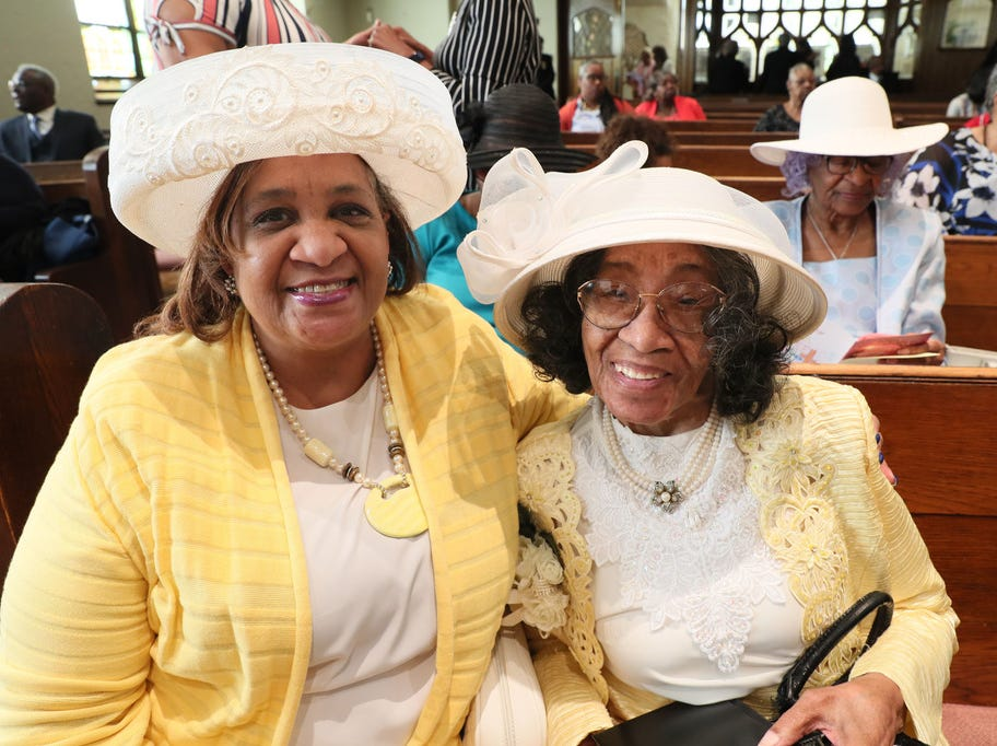 Sabrina Grant, left, and her mother, Carnell Grant, 90, attend the Covenant Missionary Baptist Church Easter service together. The Milwaukee church is celebrating its 40th anniversary this year.