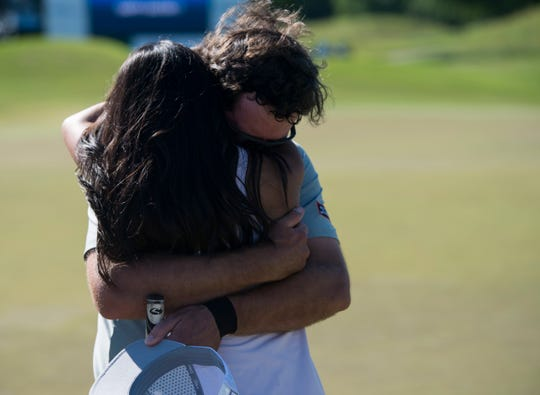 Lanto Griffin is surprised by his girlfriend, Maya Brown, after winning the tournament in a 4-hole playoff during the final round of the Robert Trent Jones Championship at the Capitol Hill Golf Course in Prattville, Ala., on Sunday, April 21, 2019.