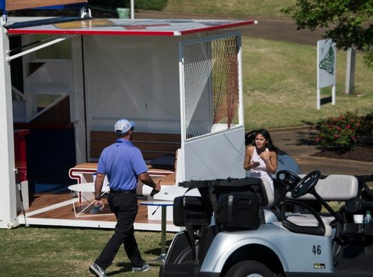 Maya Brown hides from her boyfriend, Lanto Griffin as she waits to surprise him during the final round of the Robert Trent Jones Championship at the Capitol Hill Golf Course in Prattville, Ala., on Sunday, April 21, 2019.