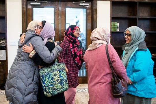 Women greet each other after midday prayer at the Islamic Center of Nashville Bellevue Mosque Friday, April 19, 2019, in Nashville, Tenn.