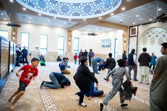 Children play after midday prayer at the Islamic Center of Nashville Bellevue Mosque Friday, April 19, 2019, in Nashville, Tenn.