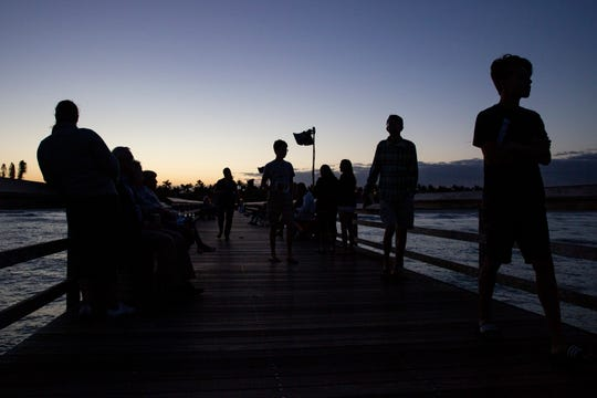 Community members gather at the Naples Pier for an Easter sunrise service hosted by the First United Methodist Church on Sunday, April 21, 2019.