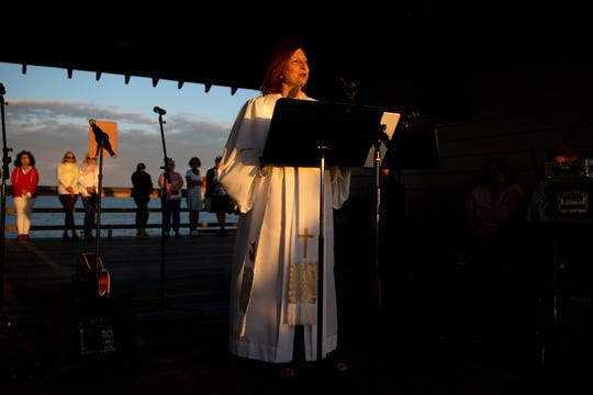 The Rev. Nancy Mayeux, from First United Methodist Church, presides over Easter Sunday sunrise service on April 21, 2019, at the Naples Pier.