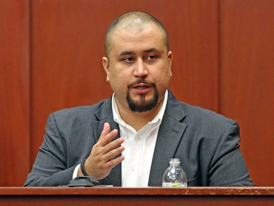 In this Sept. 13, 2016, file photo, George Zimmerman looks at the jury as he testifies in a Seminole County courtroom in Orlando. Zimmerman, the ex-neighborhood watch volunteer who killed an unarmed black teen in Florida in 2012 has been banned from the dating app Tinder. An emailed statement from Tinder cited users' safety as a reason for removing George Zimmerman's profile.