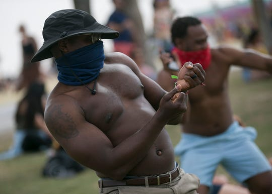Black Same (left) dances to Mr Eazi performing at the Coachella Valley Music and Arts Festival in Indio, Calif. on Sat. April 20, 2019.