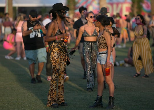 Festival goers walk through the grounds at Coachella Valley Music and Arts Festival in Indio, Calif. on Sat. April 20, 2019.