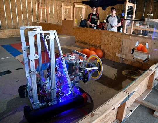 Bryce Neptune, left, and Jagr Krtanjeck, both 18, of the  Tech Fire robotics team practice running the robot for the upcoming World Championship event in Detroit, Thursday, April 18, 2019.John A. Pavoncello photo