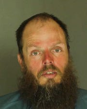 Shawn Adams, arrested for resisting arrest, disorderly conduct, harassment and public drunkenness.