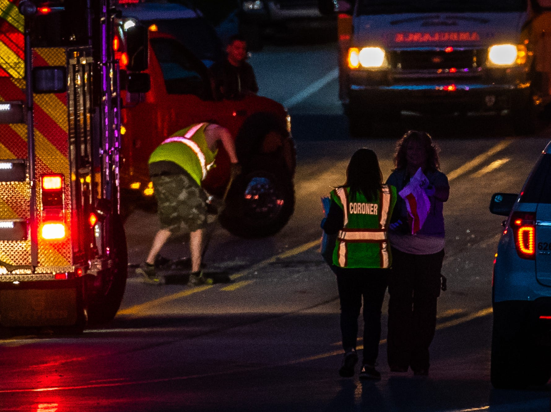A York County Coroner works at the scene of a fatal crash on the 7300 block of Lincoln Highway, Saturday, April 20, 2019, in Paradise Township.