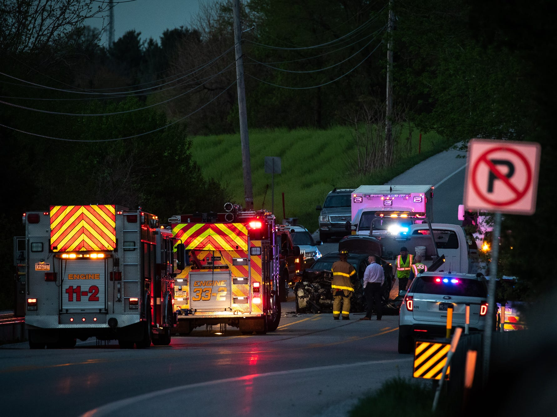 Firefighters and the York County Coroner work at the scene of a fatal crash on the 7300 block of Lincoln Highway, Saturday, April 20, 2019, in Paradise Township.