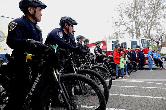 Officers with the Reno Police Department's Downtown Enforcement Team line up on their bicycles, along with other volunteers from both the Optimist Club of Reno and the Kiwanis Club of Downtown Sparks, for a photo at the first annual Optimist Club of Reno Bike Rodeo on Saturday, April 20, 2019.